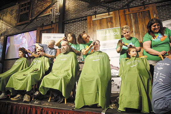 Shaved Heads Result in Fellowship Grants